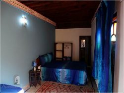 Casa Aya Medina: last floor guestroom with cactus silk curtains and bedspreads