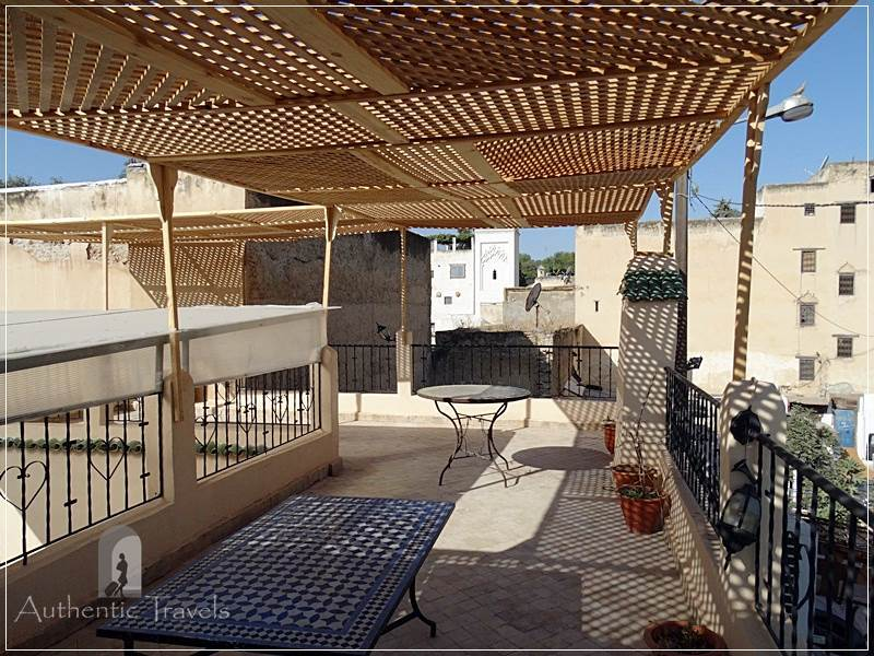 Casa Aya Medina: the upper terrace with a wooden pergola