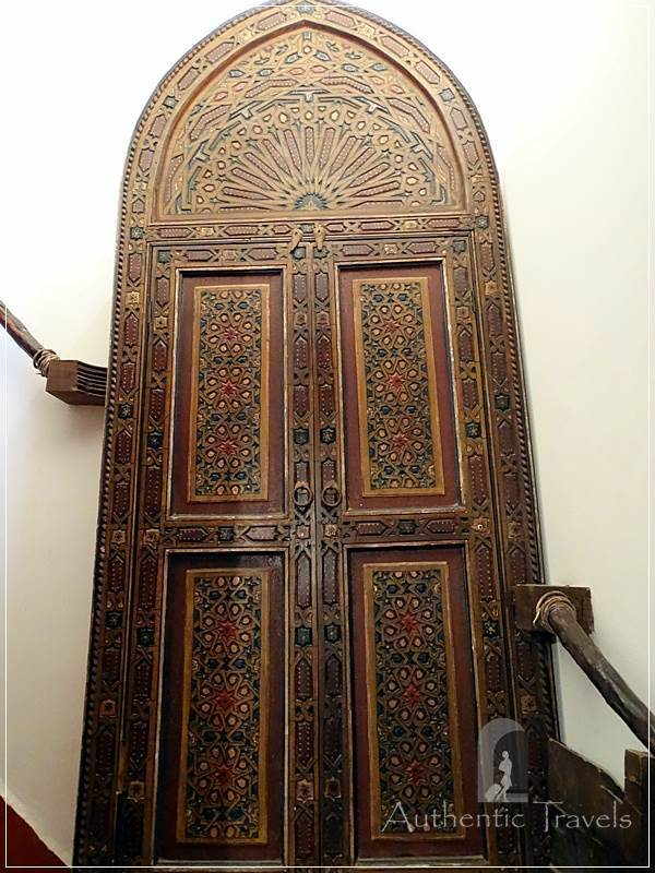 Dar Kamal Chaoui – decorative old door with a bookstore behind