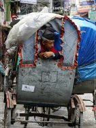 Kathmandu - Thamel - rickshaw driver waiting for his clients