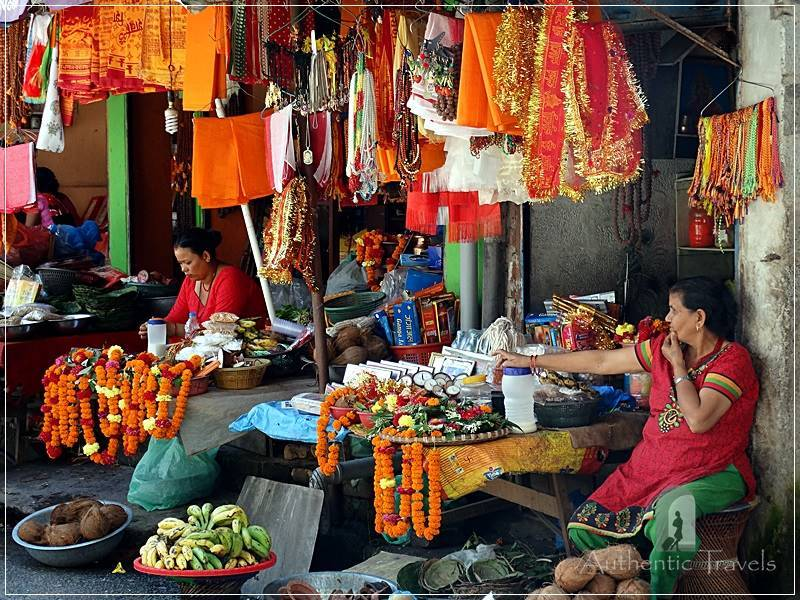 Budhanilkantha (around Kathmandu) - women selling orange flowers for offerings at the temple