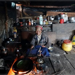 Tamang Heritage Trail - Day 3: Brimdang hamlet - local woman cooking nettle sauce for dhal bhat