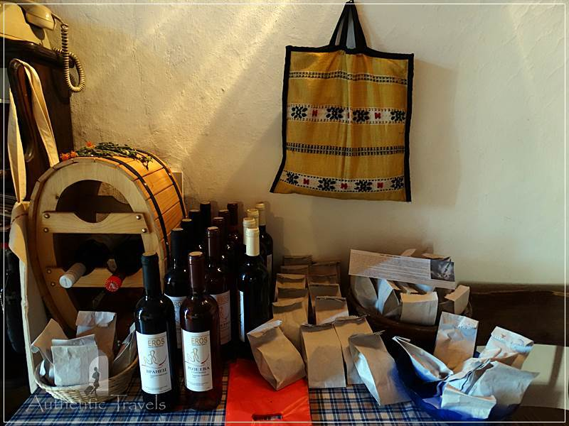 Etno House Shancheva - traditional products displayed in the lobby of the house (wine, brandy, rakija, aromatic salt, and dried herbs)