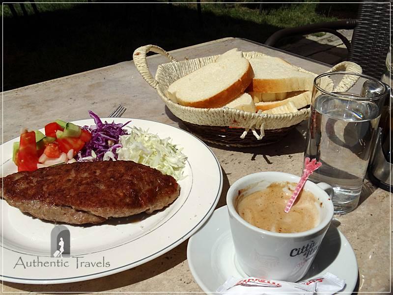 Pleskavice sharri (stuffed with cheese inside) and cappuccino